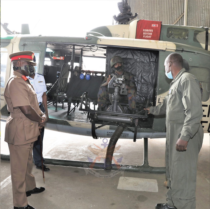 Chief of the Defence Forces General Robert Kibochi observing modifications made on a Huey helicopter during his visit to Moi Air Base.